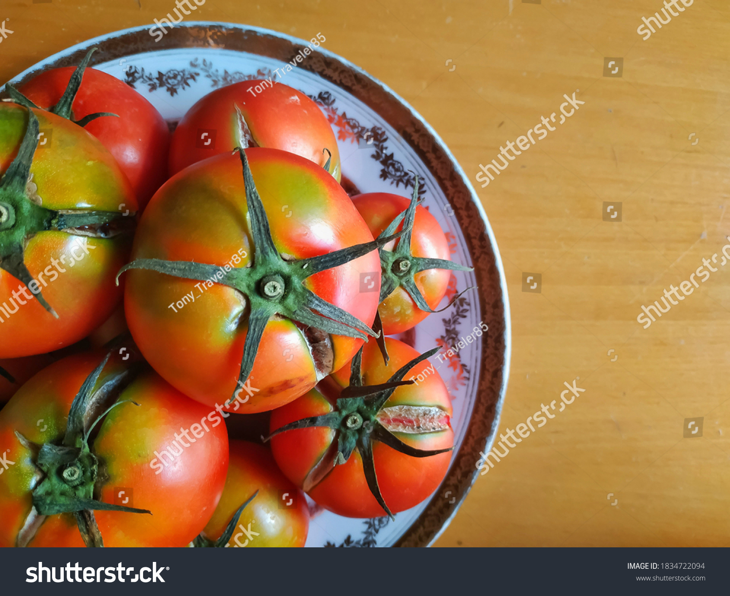 stock-photo-juicy-red-tomatoes-on-a-plat