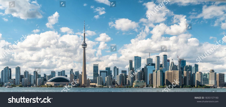 Panoramic view of Toronto skyline and Lake Ontario on a sunny day, Toronto, Ontario, Canada.  #1835157190