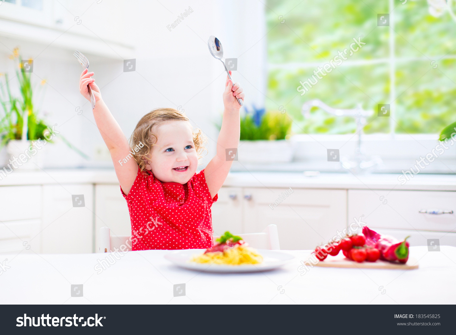 Cute curly laughing toddler girl in a red shirt playing for How to get spaghetti sauce out of a white shirt