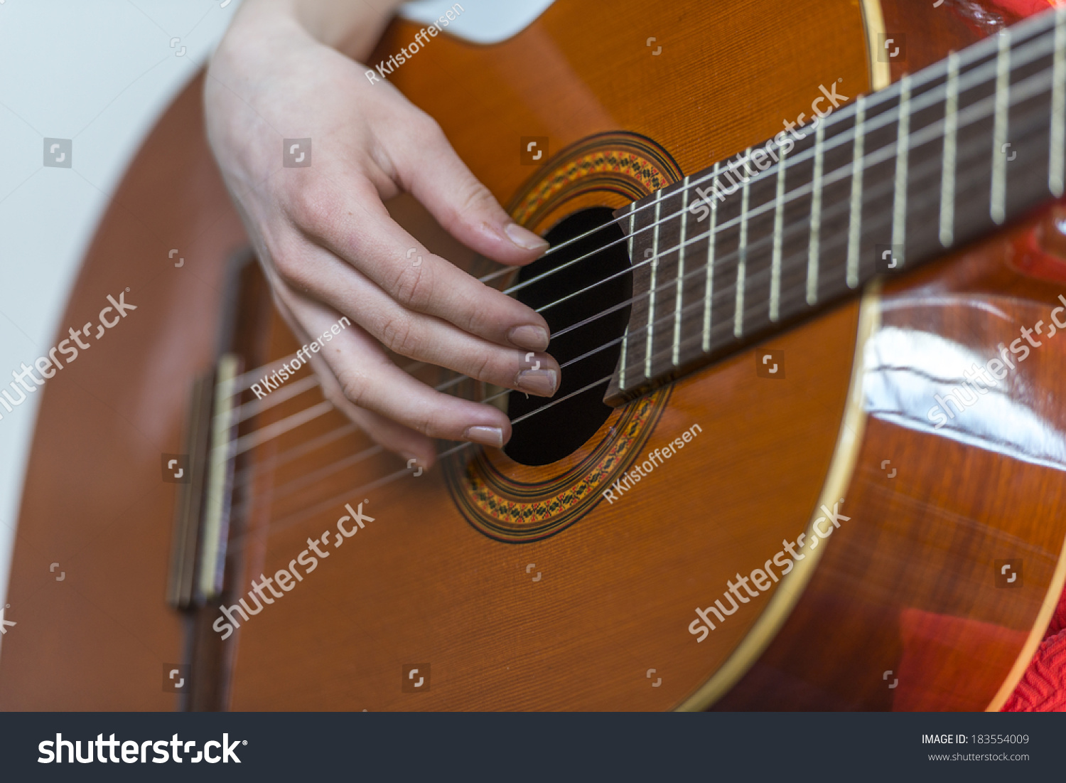 Closeup Female Hand Playing Acoustic Guitar Stock Photo ...