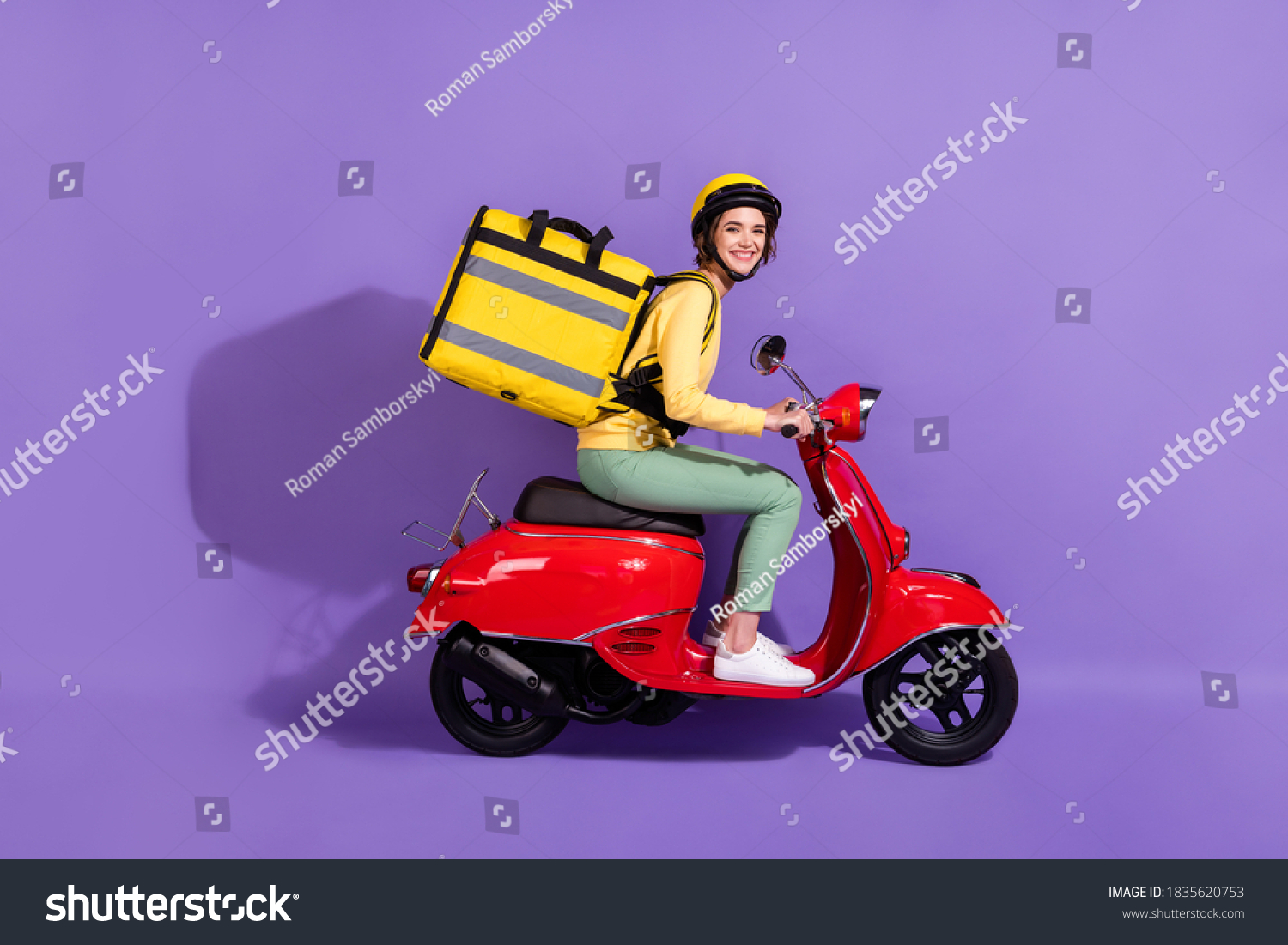 Profile side view of her she nice attractive cheerful girl riding bike delivering, bringing cafe food order fast speed express isolated bright vivid shine vibrant lilac violet purple color background #1835620753