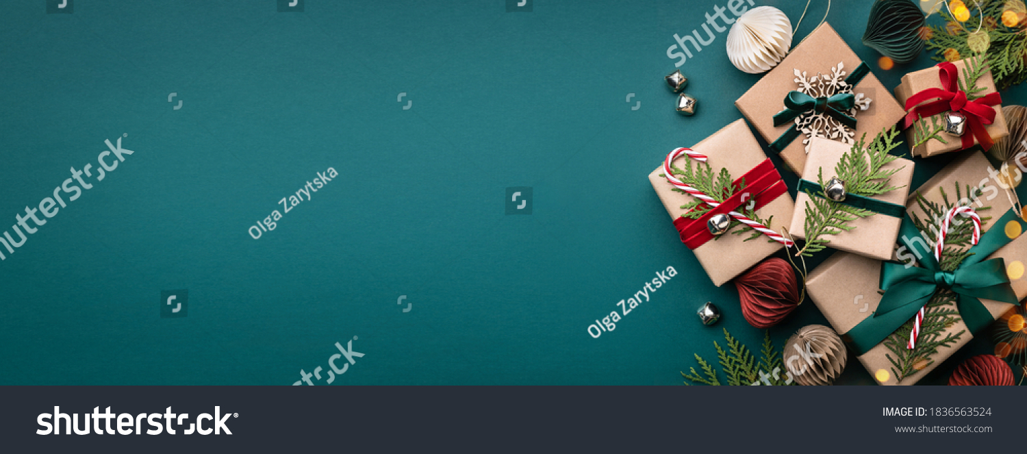 Banner with many gift boxes tied velvet ribbons and paper decorations on turquoise background. Christmas background. #1836563524