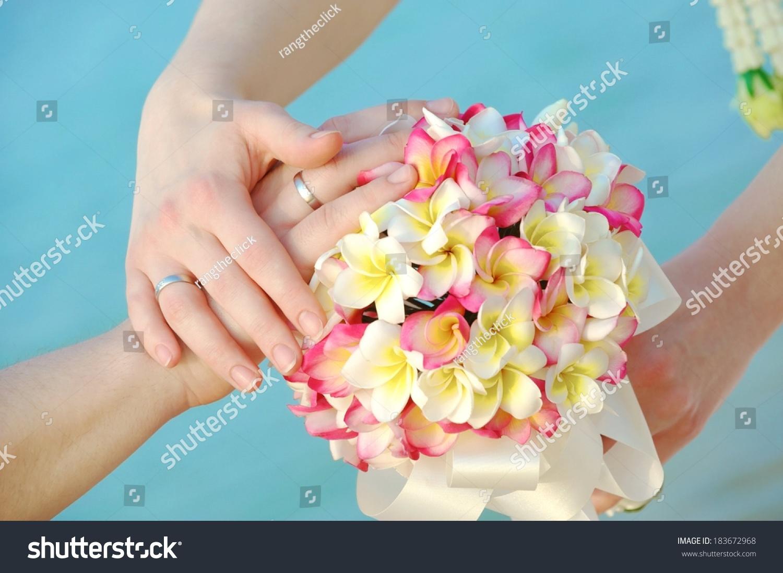 Wedding ring on flower bouquet frangipani stock photo edit now wedding ring on flower bouquet frangipani flowers or plumeria izmirmasajfo