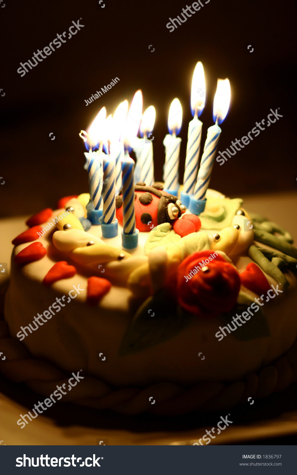 Close Up Of A Birthday Cake All Lit In The Dark