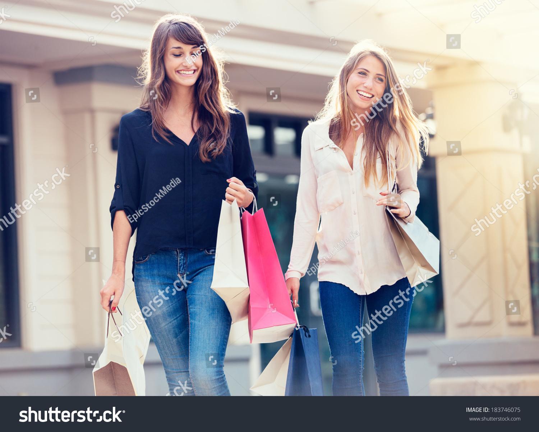 beautiful girls shopping bags walking mall stock photo 183746075