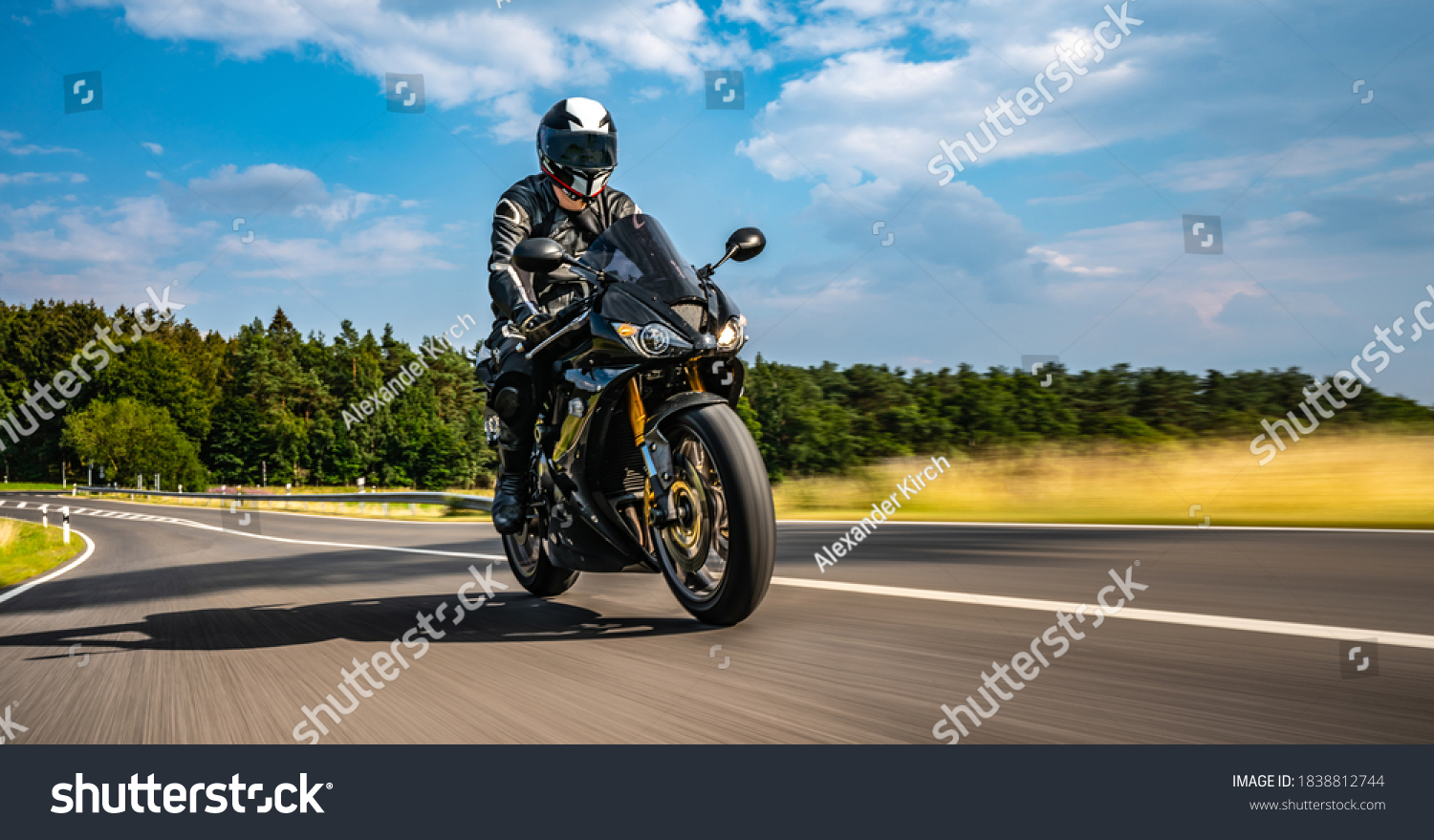 motorbike on the road riding. having fun driving the empty road on a motorcycle tour journey. copyspace for your individual text. Fast Motion Blur effect #1838812744