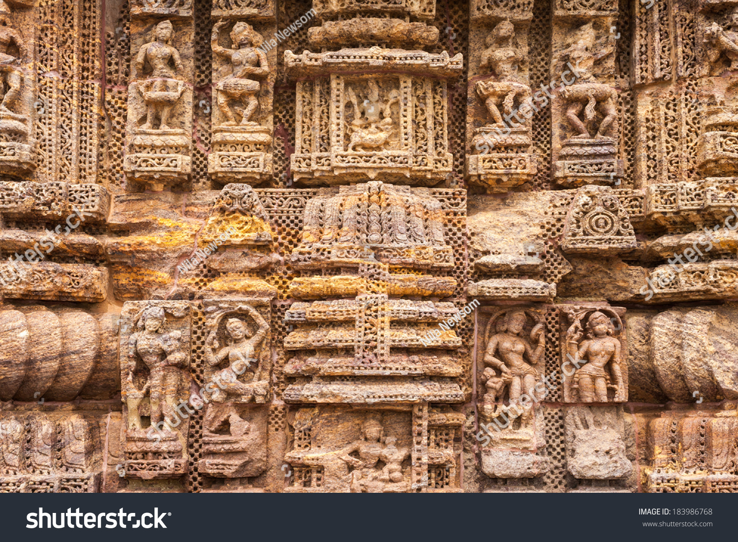 Ancient sandstone carvings on walls stock photo