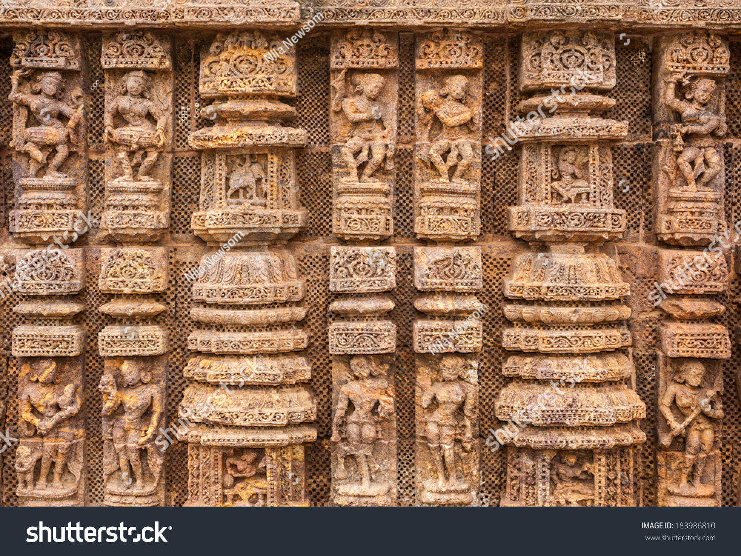 Ancient sandstone carvings on the walls of