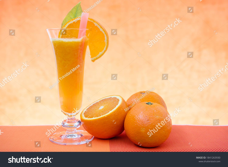 stock-photo-orange-juice-and-slice-on-th