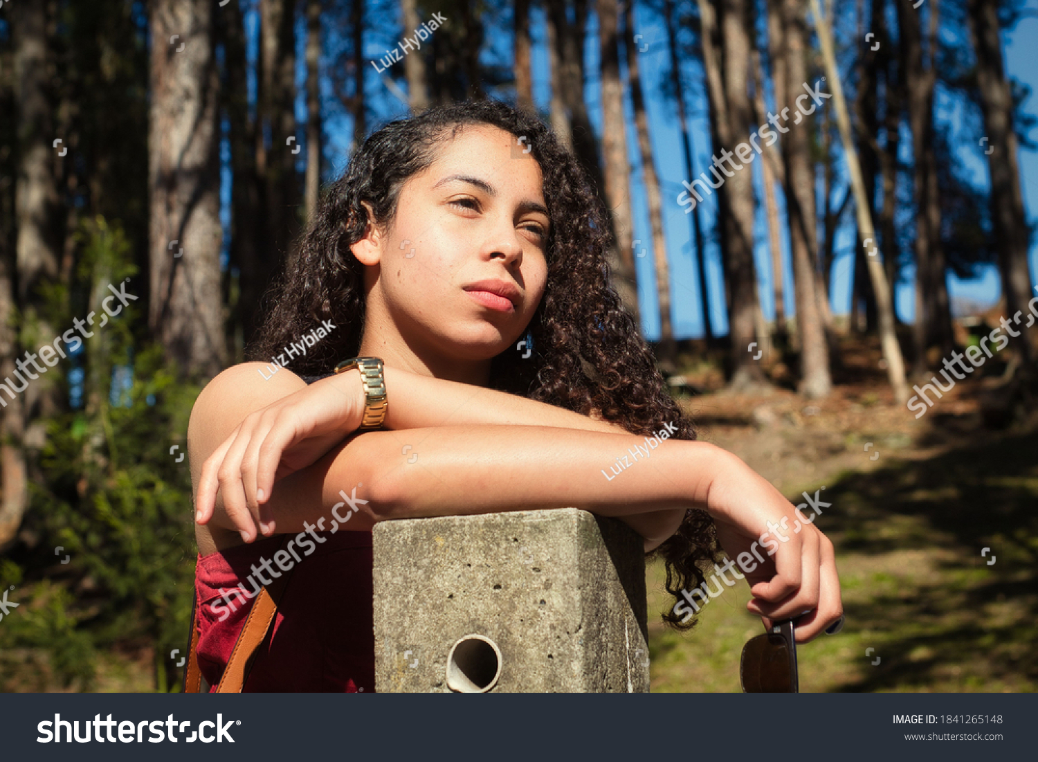 stock-photo-young-adult-woman-with-curly