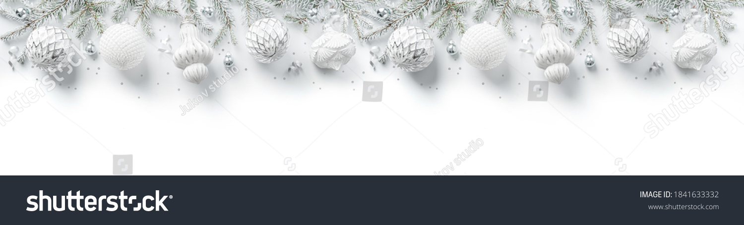 Merry Christmas wreath made of fir branches, white and silver decorations, sparkles and confetti on white background. Xmas and New Year holiday, bokeh, light. Flat lay, top view, wide banner #1841633332
