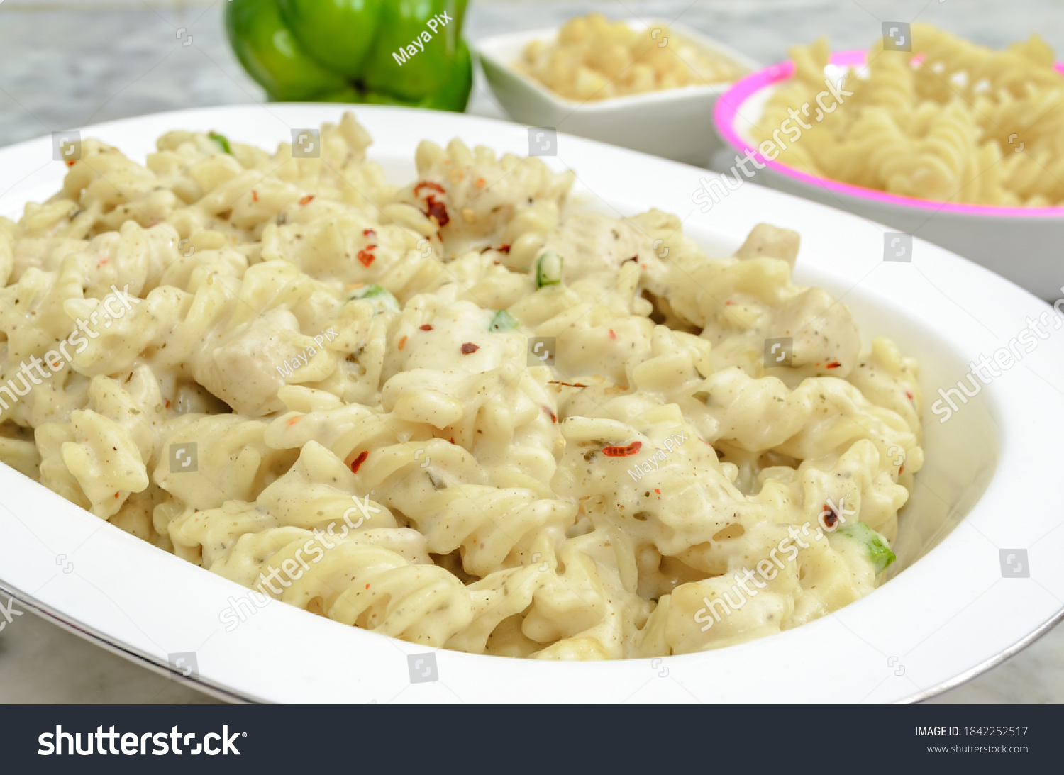 Creamy White Sauce Chicken Pasta along with the ingredients beside.