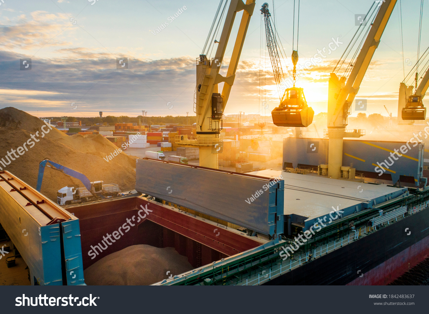 Large international transportation vessel in the port, loading grain during sunrise for export in the sea waters. #1842483637
