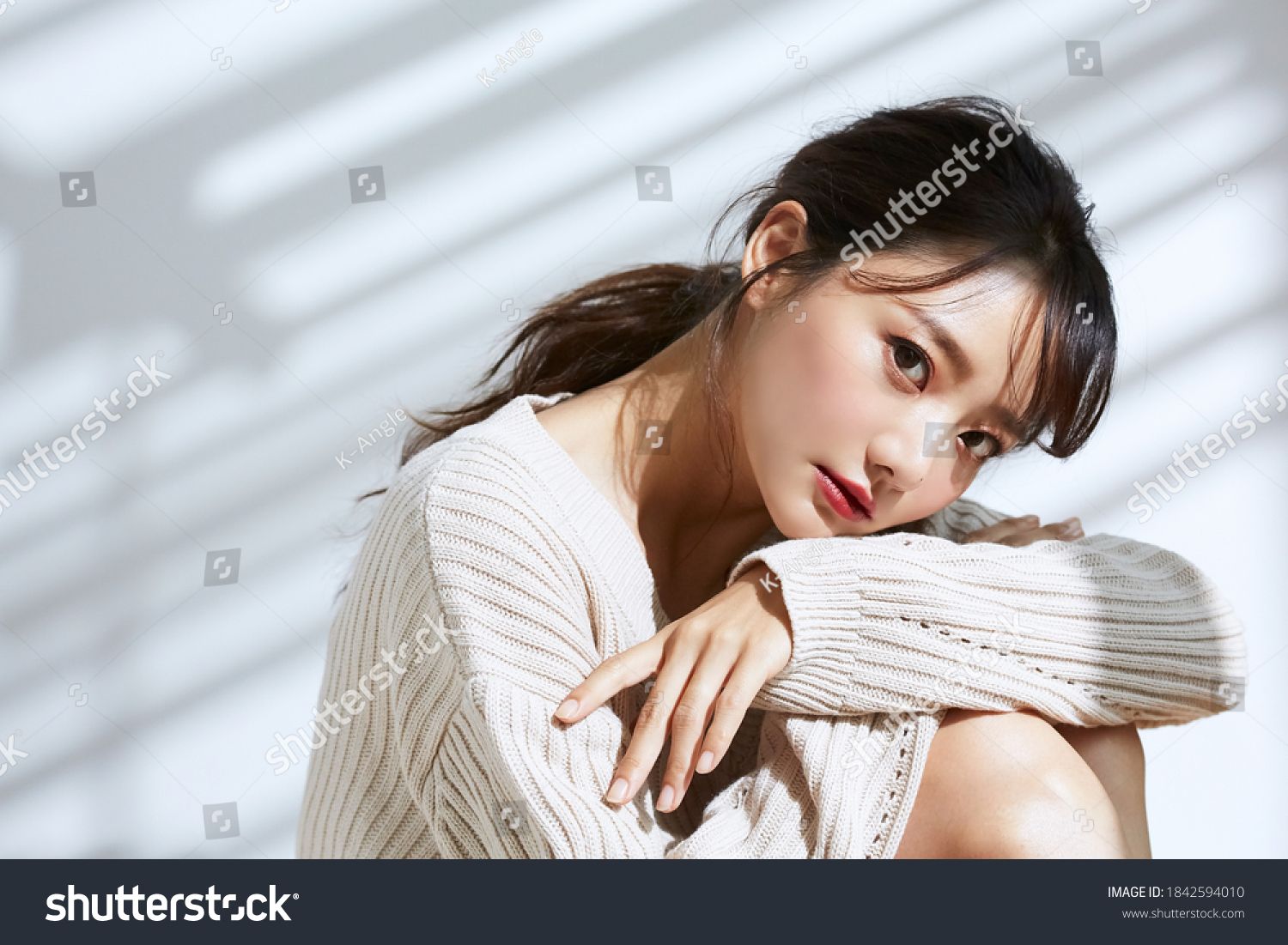 Beauty portrait of young Asian women on light and shadow background #1842594010