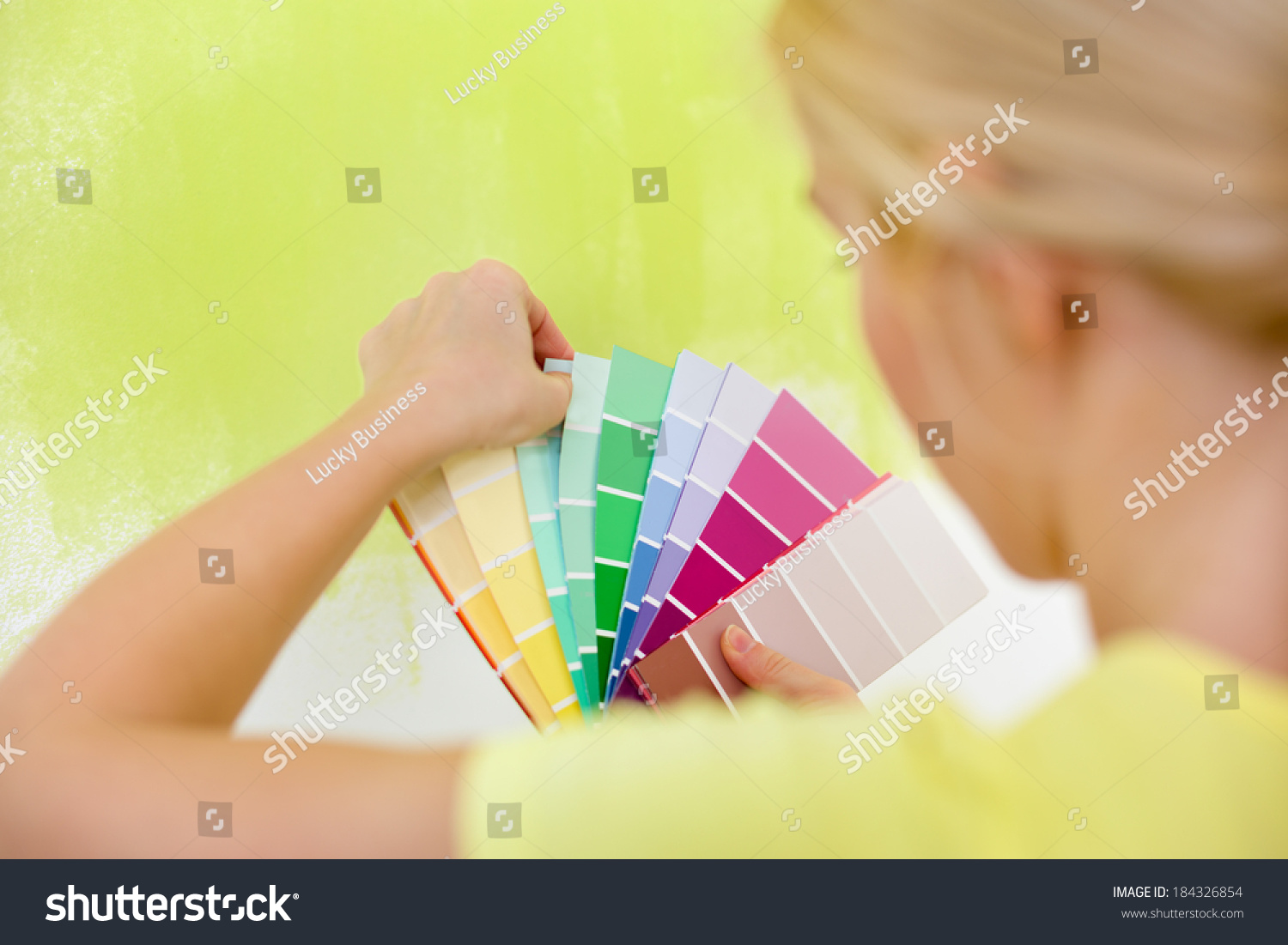Woman Choosing Color Painting Wall Stock Photo (Edit Now) 184326854 ...