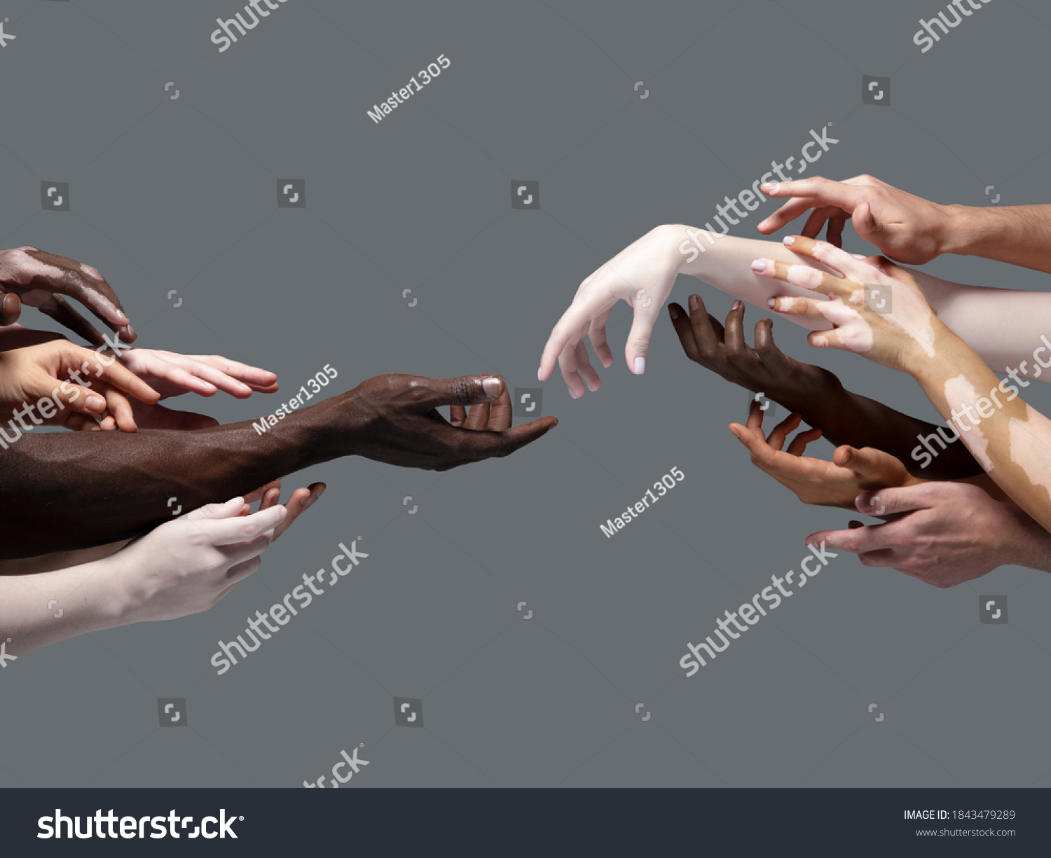 Creation of Adam. Hands of different people in touch isolated on grey studio background. Concept of relation, diversity, inclusion, community, togetherness. Weightless touching, creating one unit. #1843479289