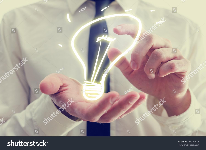 Technology Management Image: Retro Image Businessman Holding Creative Light Stock Photo