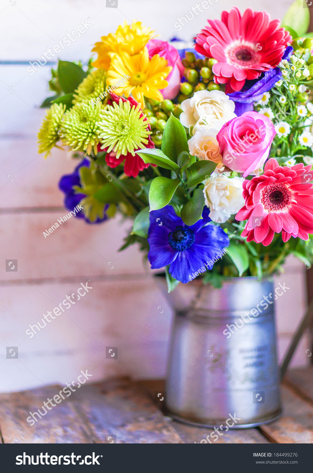 Colorful bouquet of spring flowers in vintage vase on rustic wooden id 184499276 izmirmasajfo