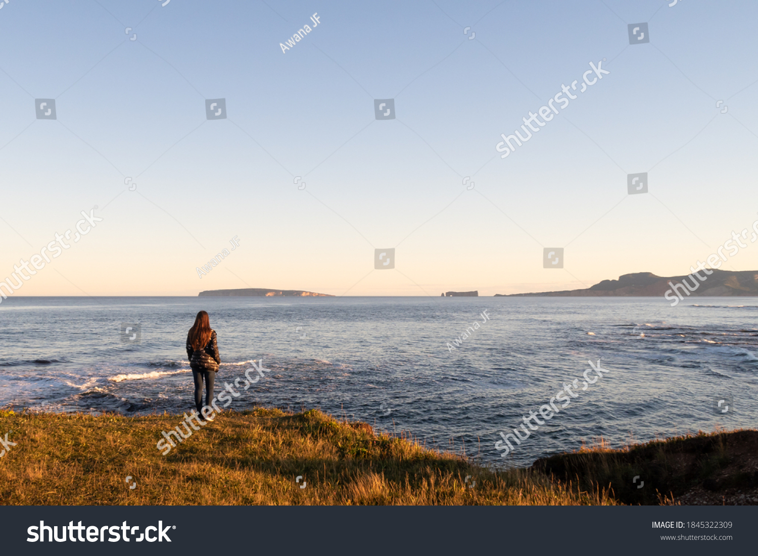 stock-photo-young-woman-standing-on-the-