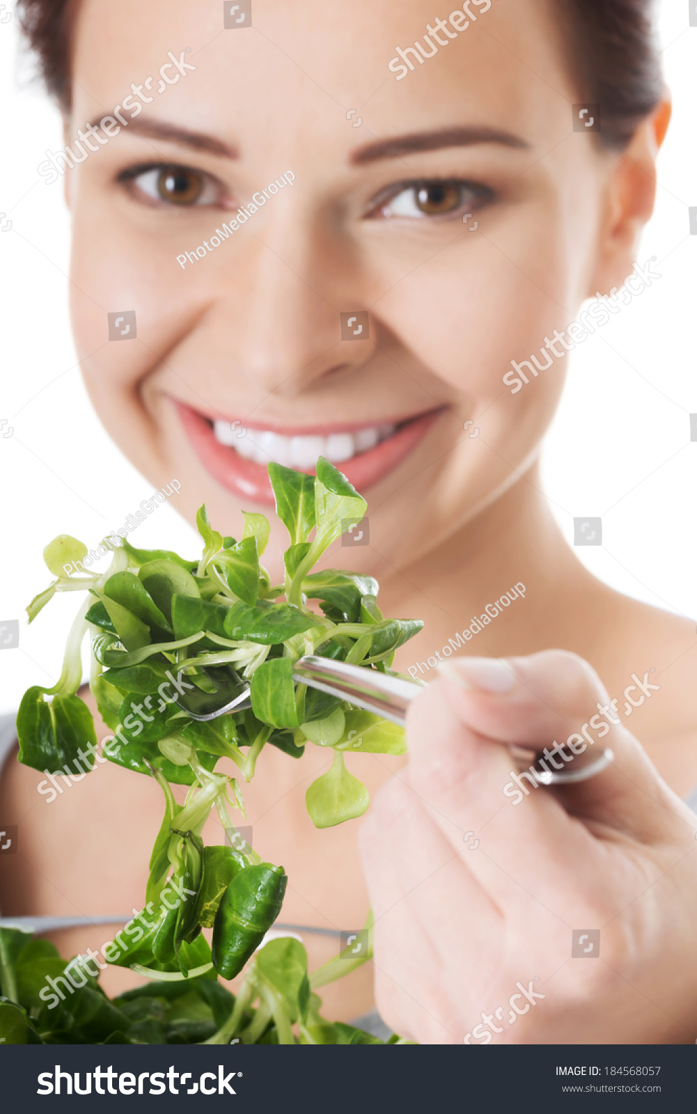 Beautiful Eat In Kitchens: Beautiful Woman Eating Lettuce Isolated On Stock Photo