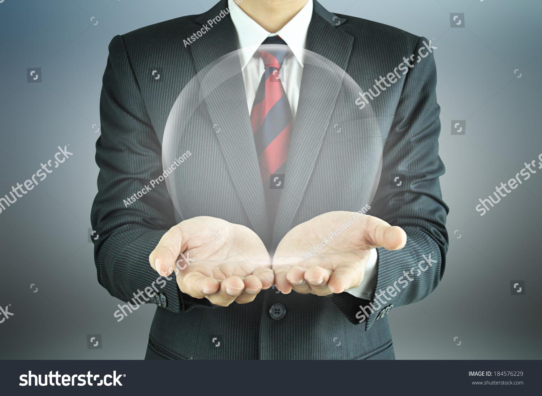 Businessman hands holding empty transparent sphere  #184576229