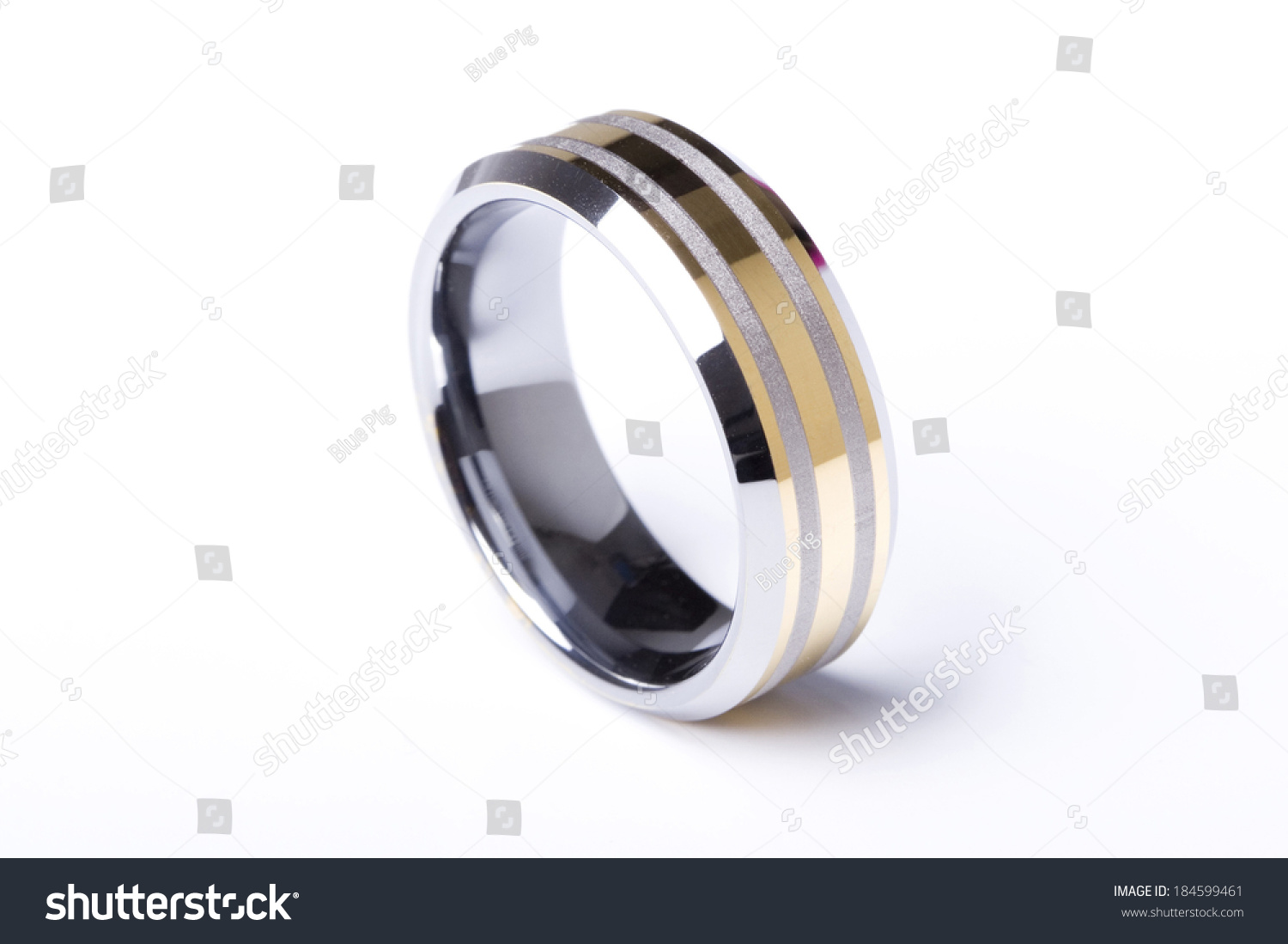 a plain wedding ring band made out of silver and gold