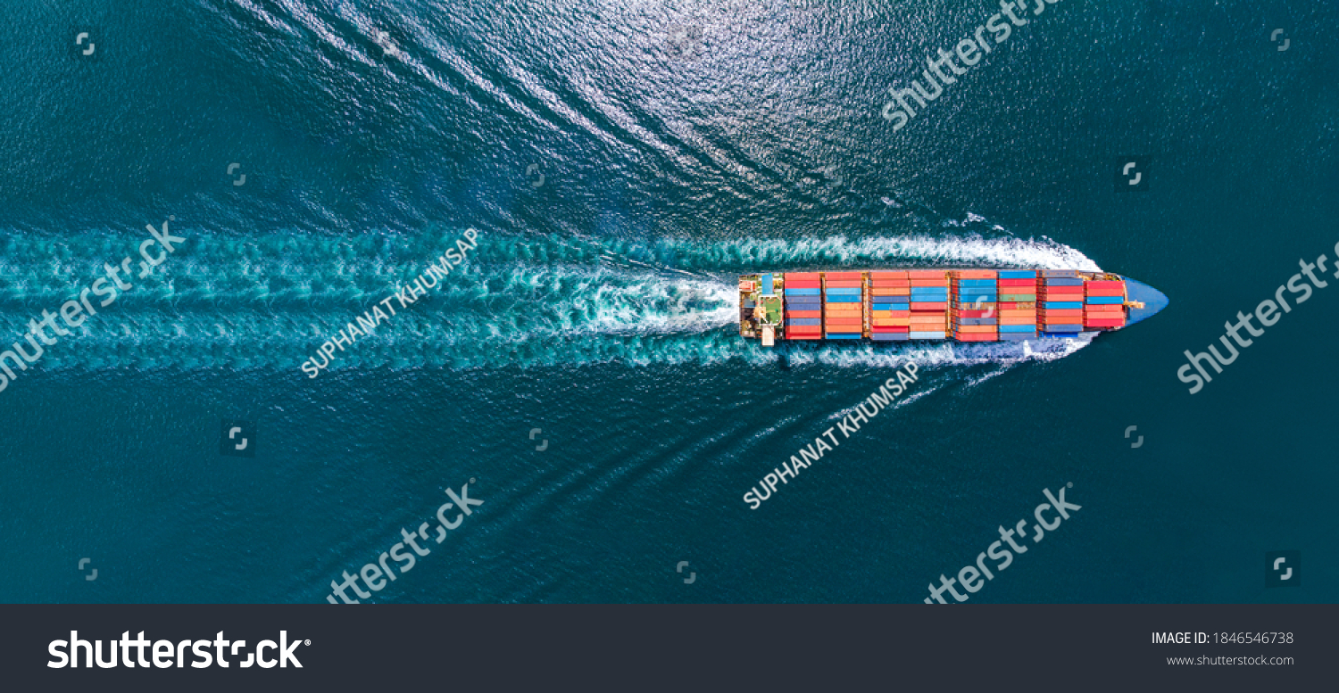 Aerial top view of cargo maritime ship with contrail in the ocean ship carrying container and running for export  concept technology freight shipping by ship smart service #1846546738