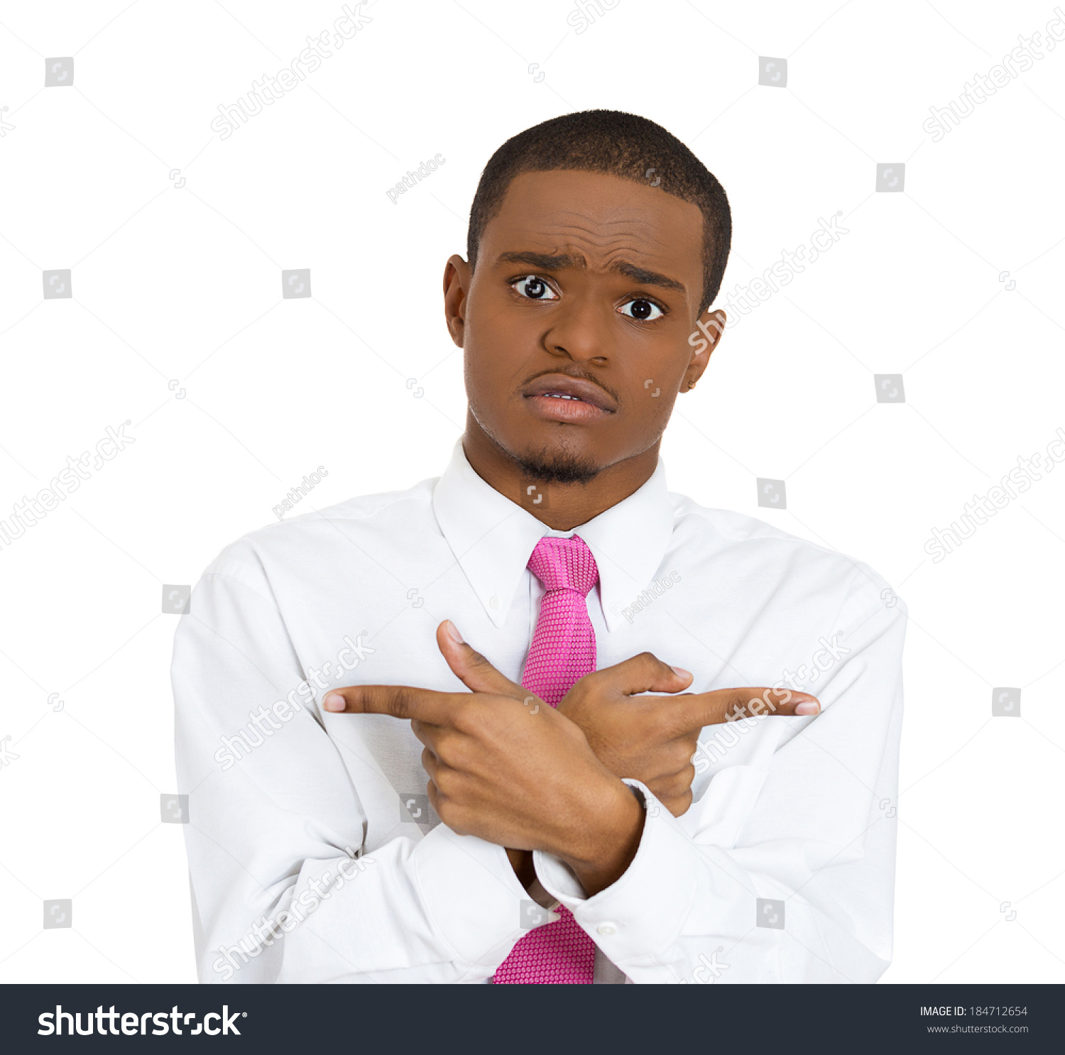 Closeup Portrait Confused Young Man Pointing In Two Different Directions Not Sure Which Way