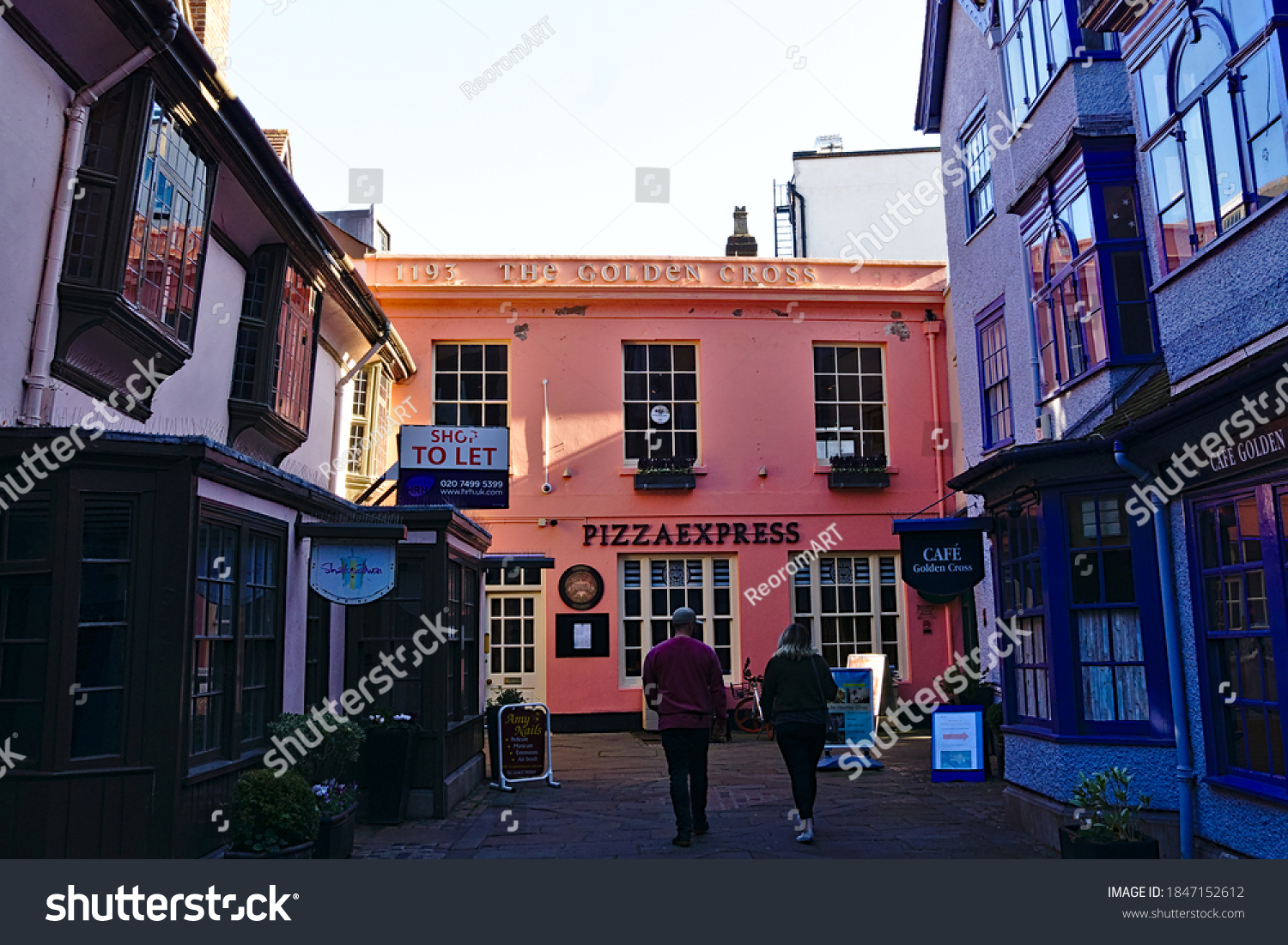 Pizzaexpress, Pinnk color building next to Covered Market, Oxford,England on 22/11/2019.
