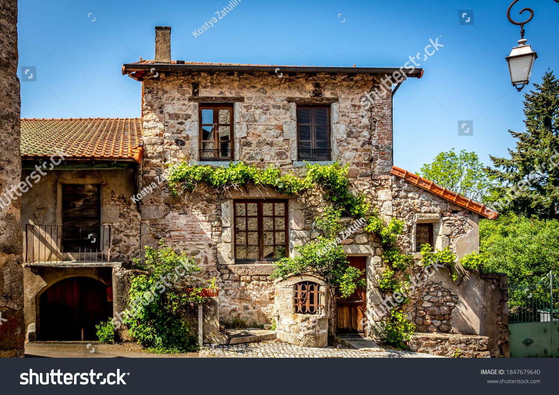 Old european stone house exterior view. Stone cottage house. Stone house exterior. Cute stone cottage house #1847679640