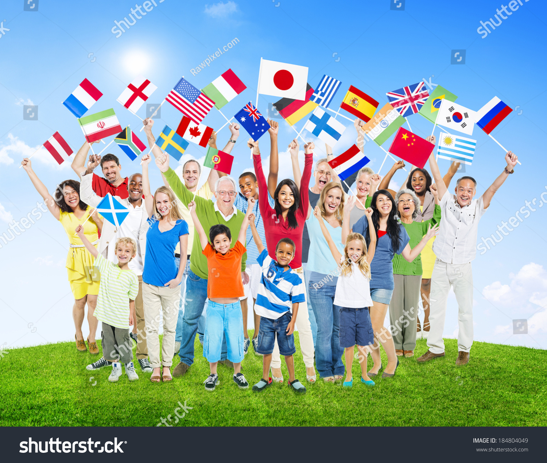 Ethnic National: Multiethnic People Holding National Flags World Stock
