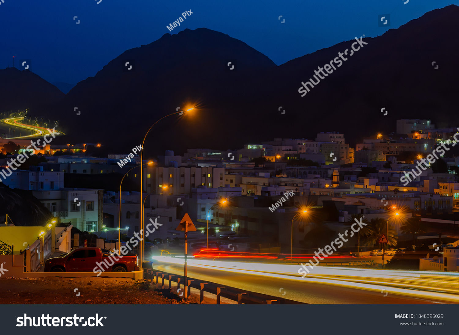 Car Motion Trails on a peaceful night in a small town in Muscat, Oman.