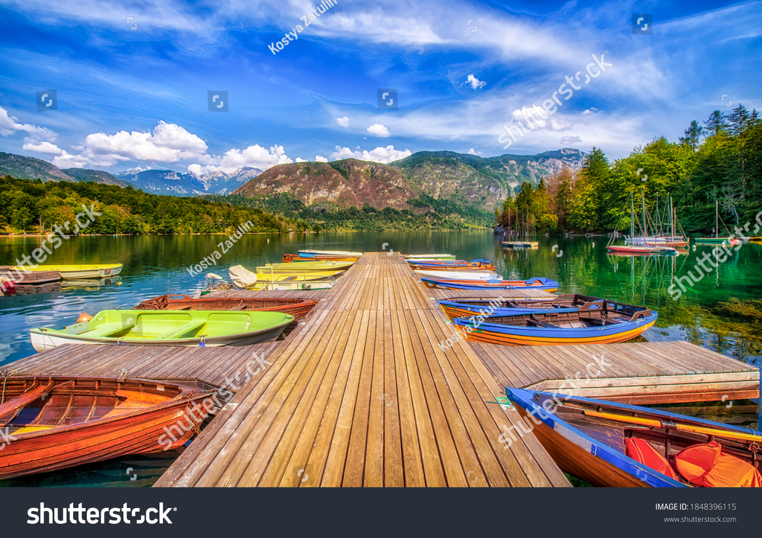 Boat dock on the lake. Lake pier boats. Boats on lake dock. Boats on lake pier #1848396115