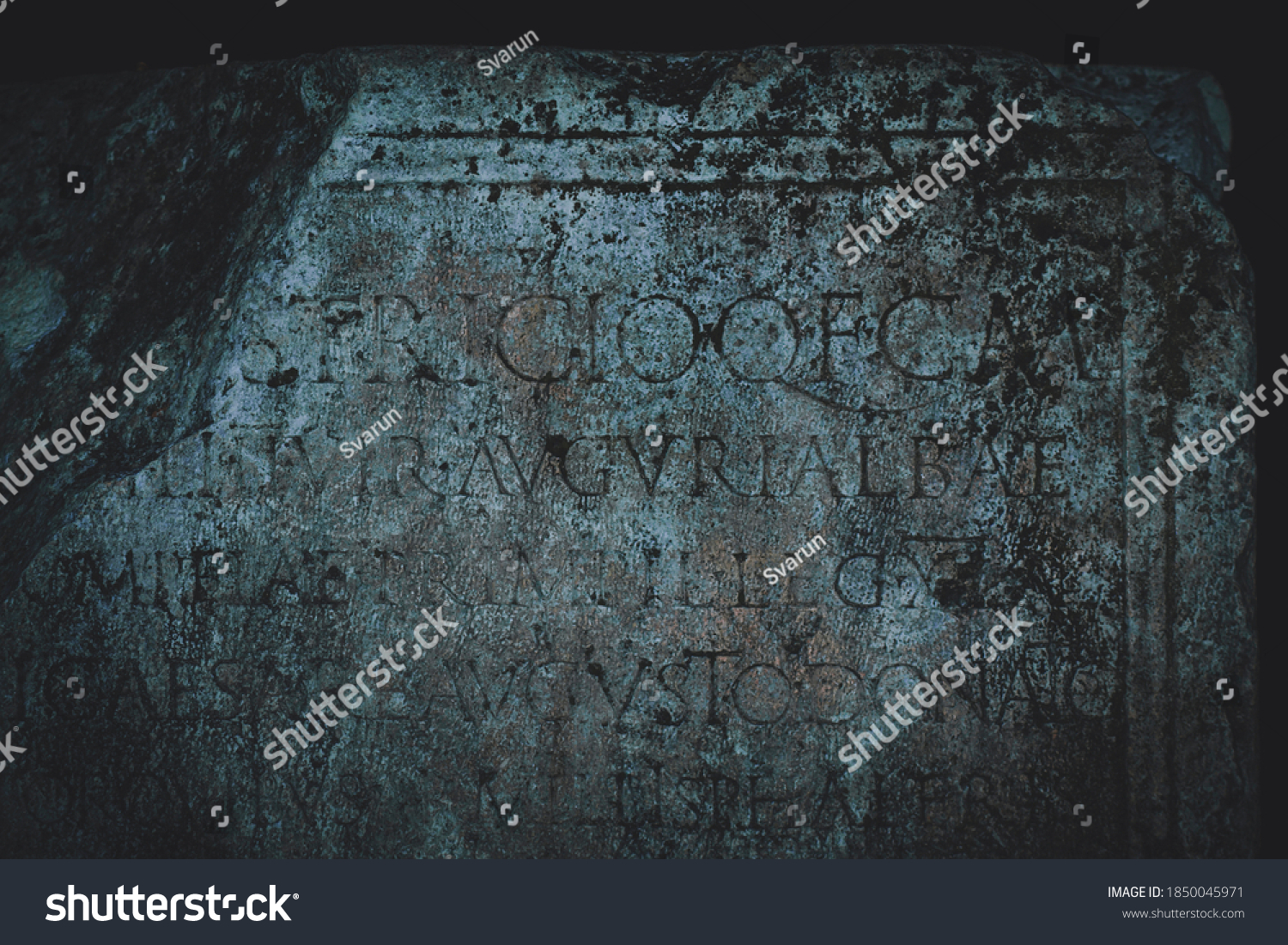 Ancient Roman letters carved in stone. Roman text and inscriptions. Can be used as a background or a book cover