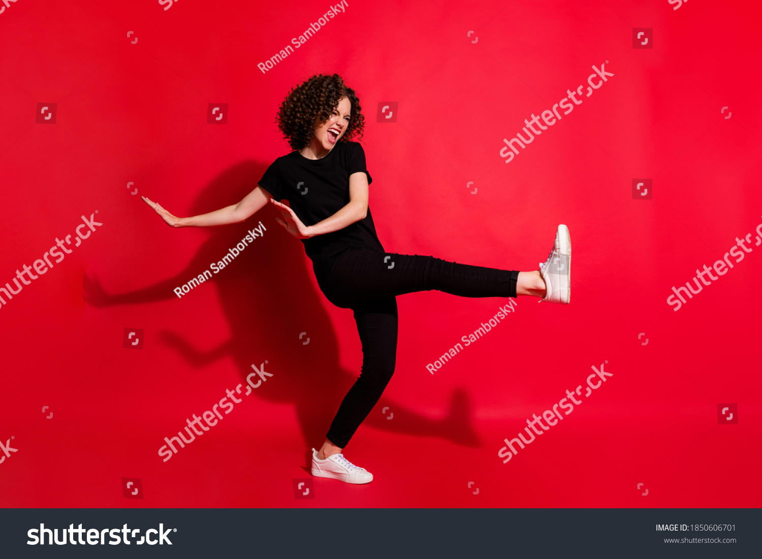 Photo portrait full body view of girl kicking raising leg dancing isolated on vivid red colored background #1850606701