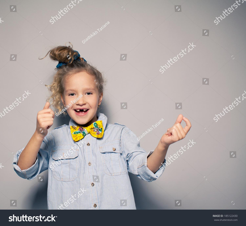 Dansing child Motions fashion girl studio shot