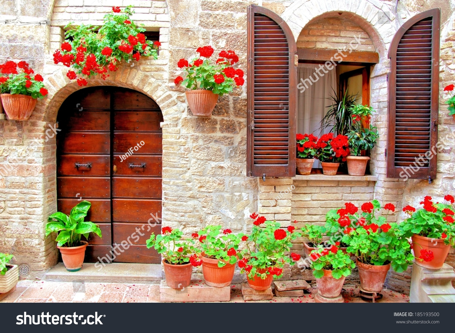 Italian house front colorful potted flowers stock photo for Italianhouse