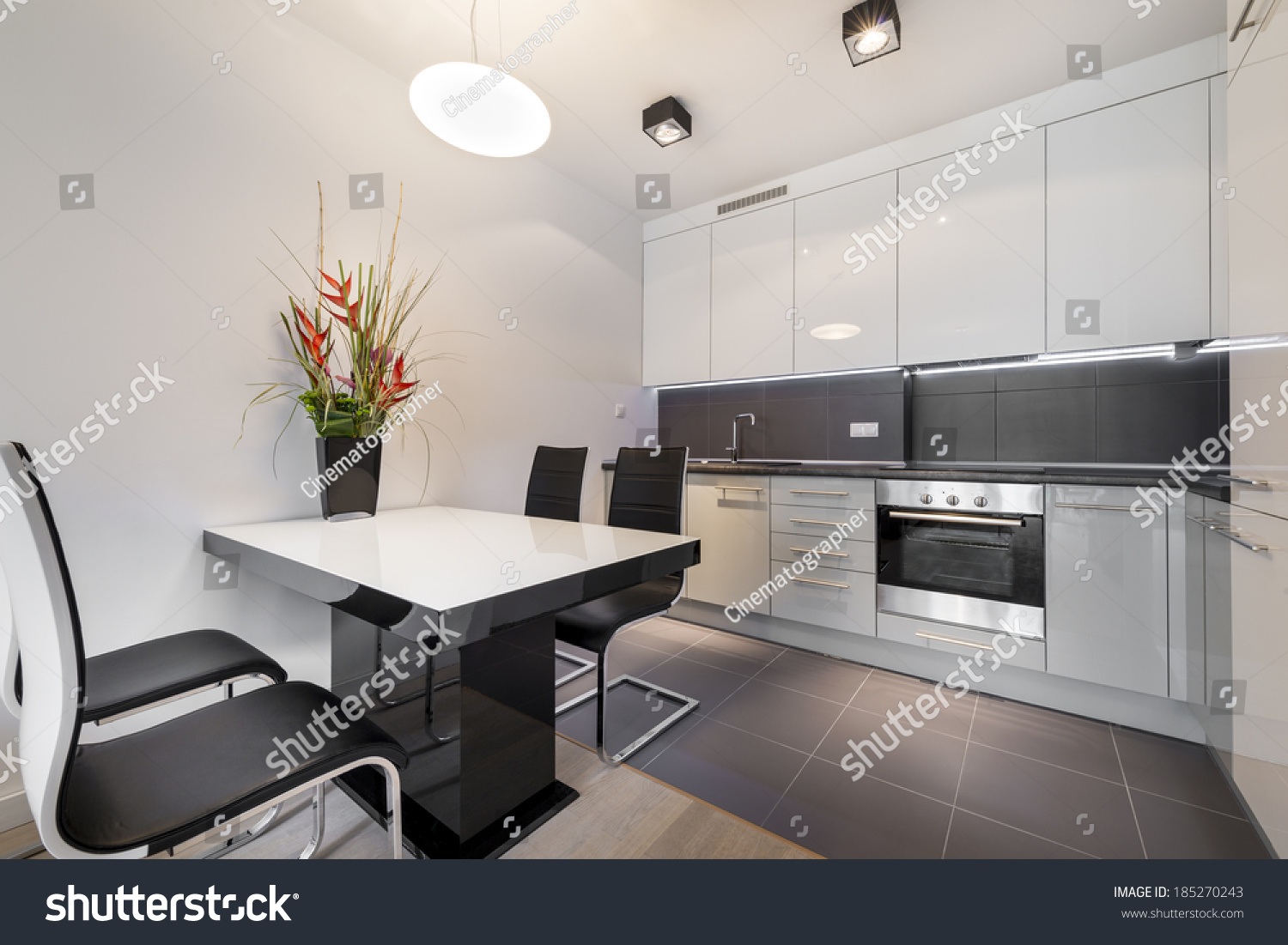 Modern kitchen with gray tile floor and white table Kitchen Gray Tile Floor White Stock Photo 185270243
