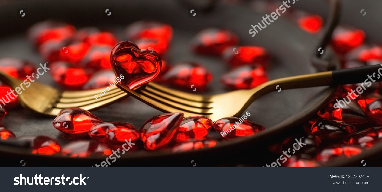 Banner. Festive table setting.Heart on a fork close-up. Holiday concept. Valentine's Day. Copy space for inscriptions. #1852802428