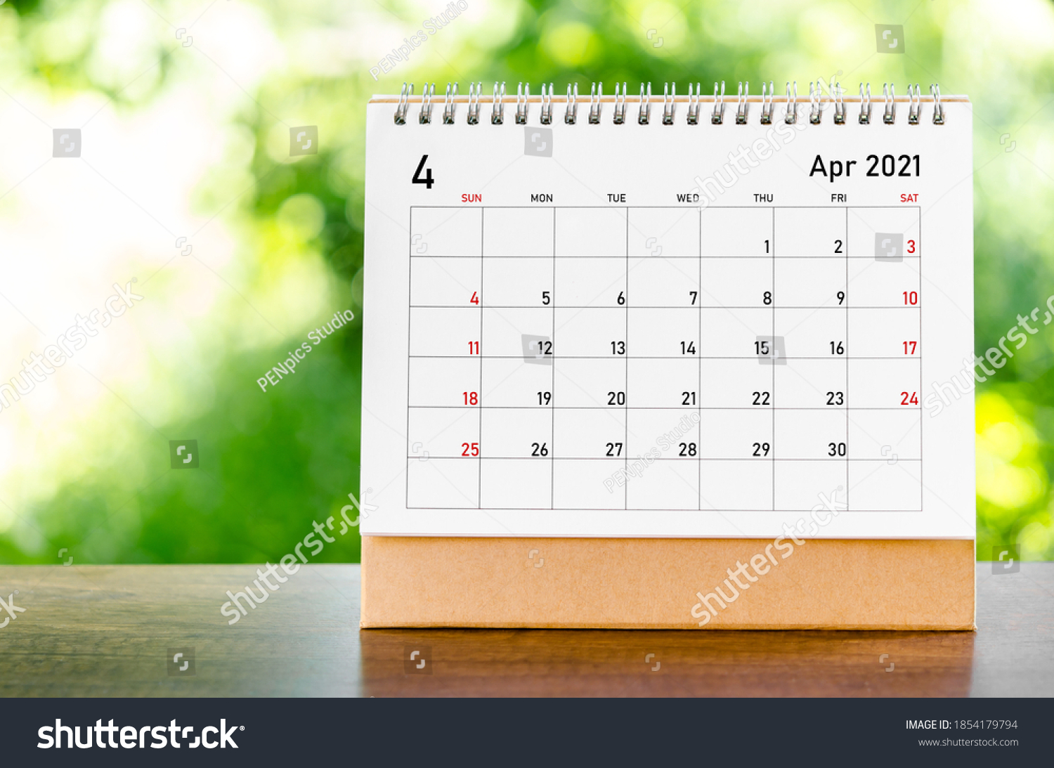 April 2021 Calendar desk for organizer to plan and reminder on wooden table on nature background. #1854179794