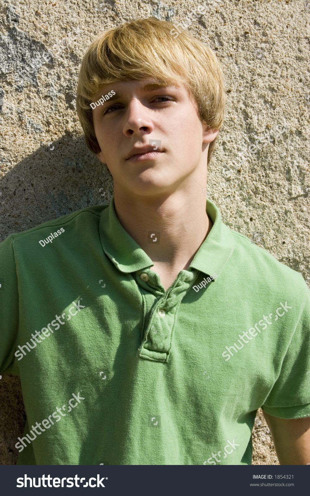 Attractive 15 Year Old Teen Boy Outside Against Old Wall