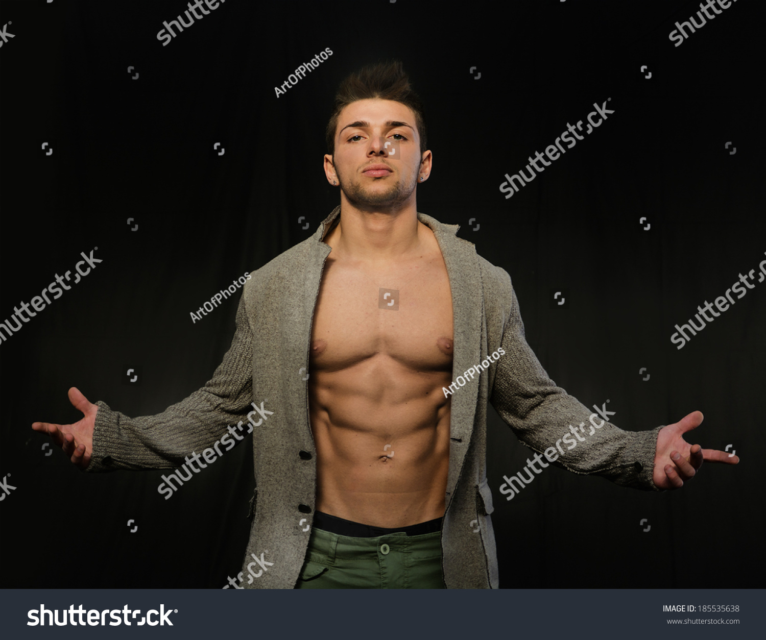 Confident, Attractive Young Man With Open Jacket On