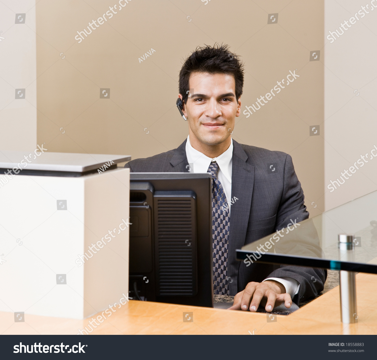 male receptionist telephone earpiece working front stock photo male receptionist telephone earpiece working at front desk