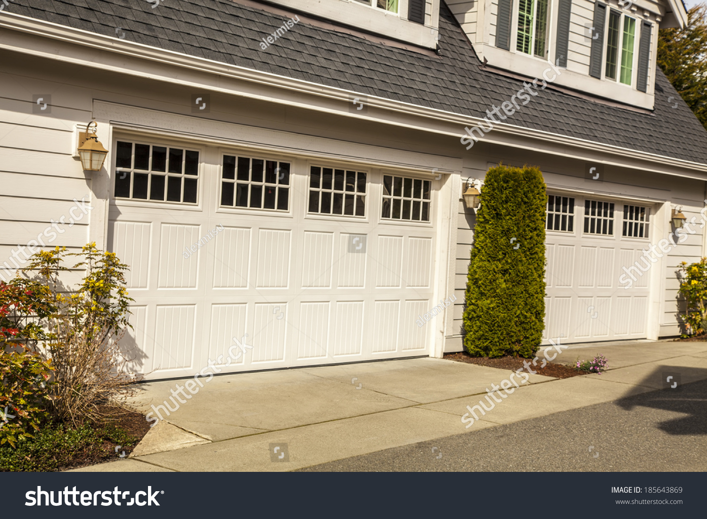 Two White Garage Doors Windows Stock Photo 185643869 - Shutterstock
