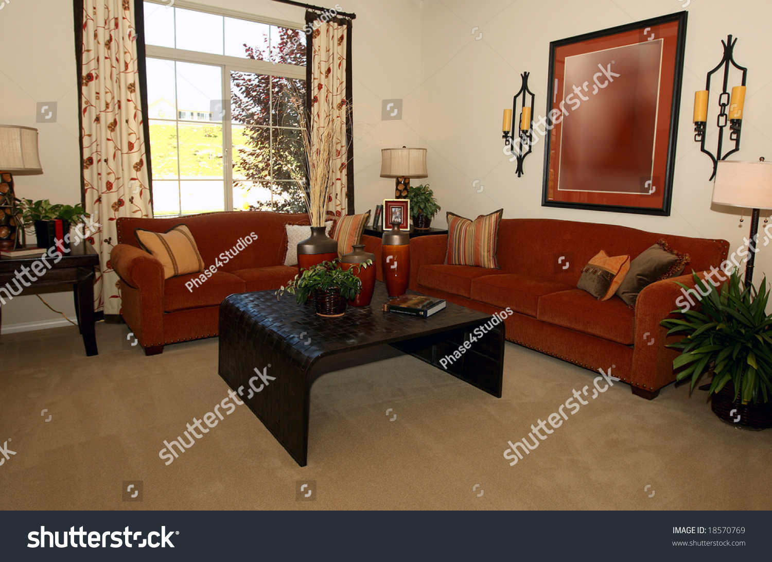Modern Comfortable Living Room In Warm Hues Stock Photo