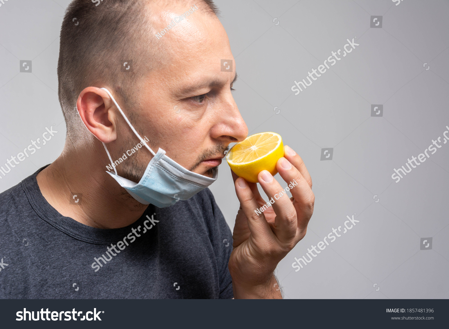 Anosmia or smell blindness, loss of the ability to smell, one of the possible symptoms of covid-19, infectious disease caused by corona virus. Man Trying to Sense Smell of a Lemon #1857481396