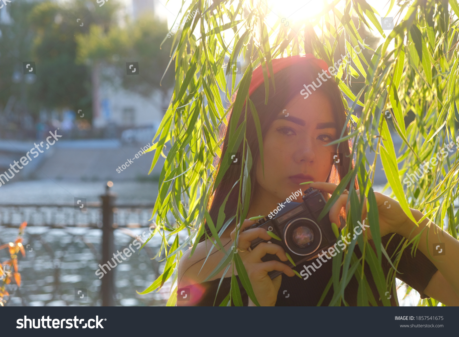 stock-photo-vintage-film-camera-in-hands