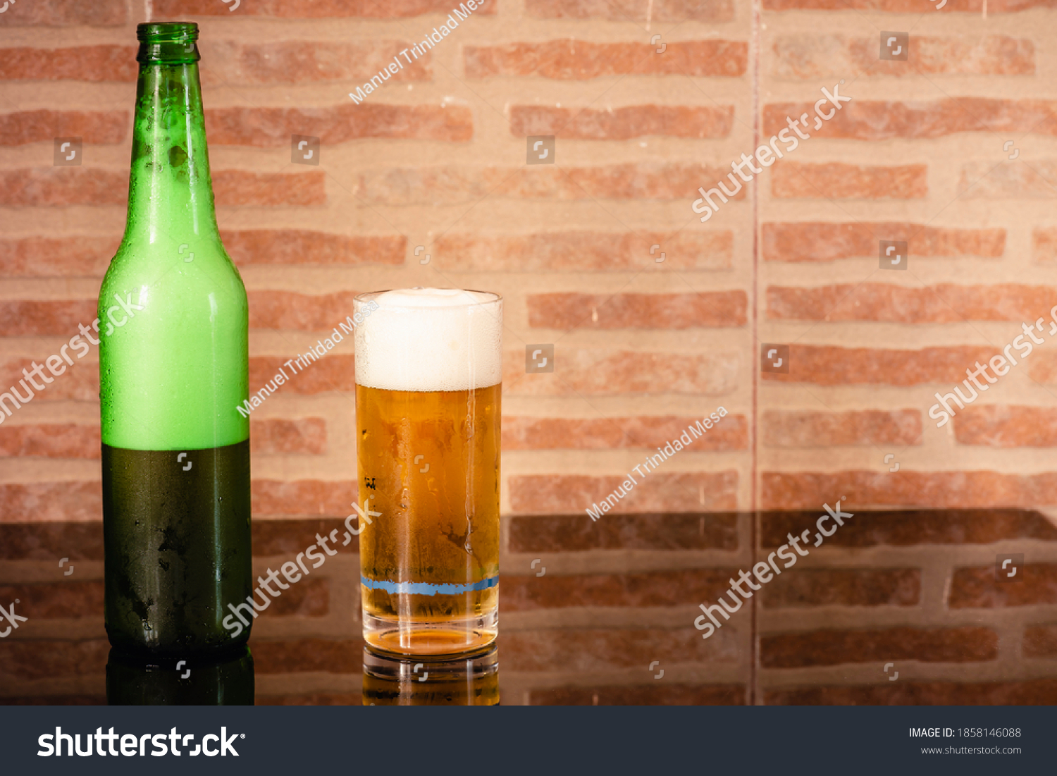 stock-photo-glass-of-beer-and-a-green-bo