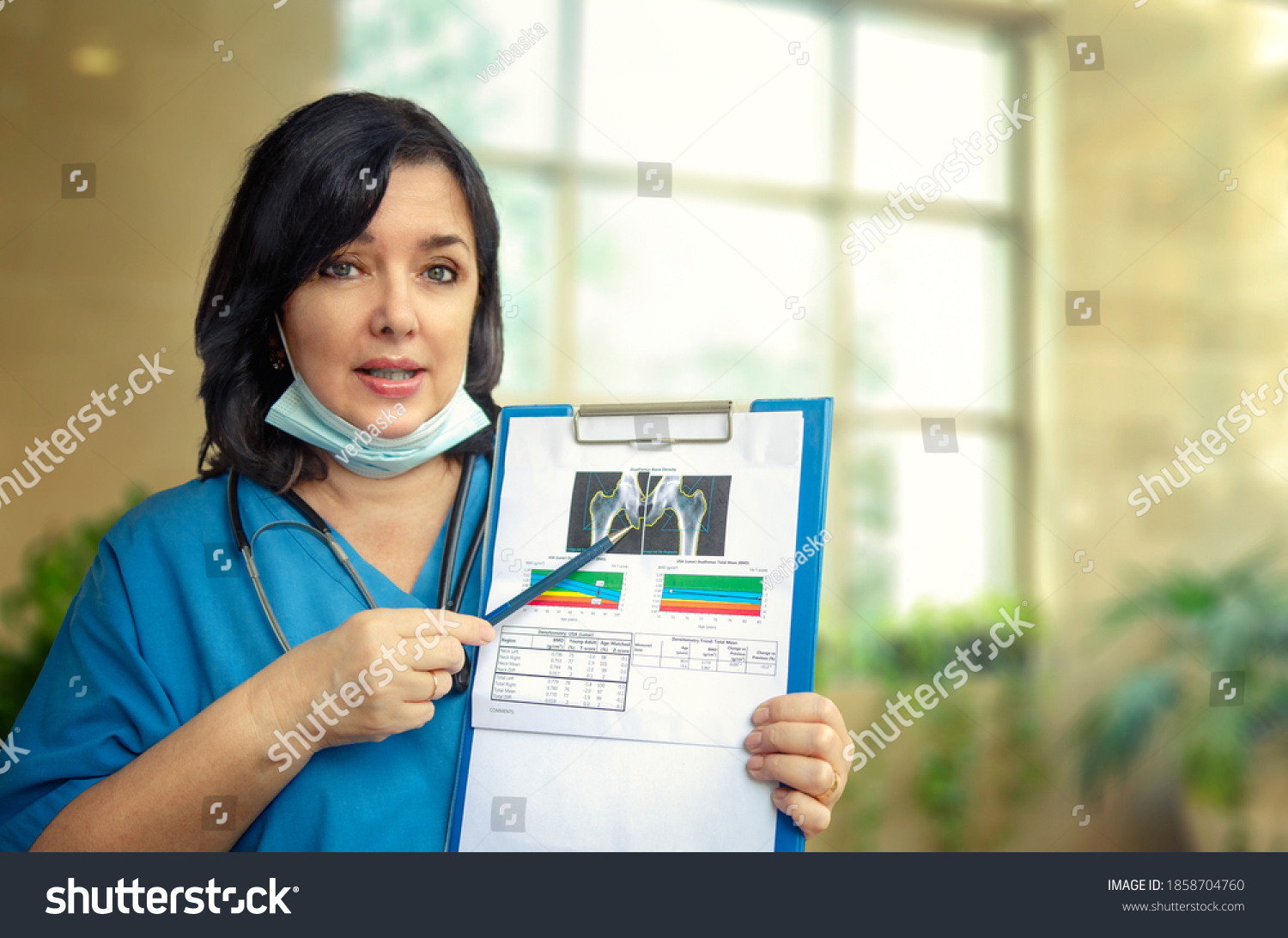Medical woman explaining why to do a bone mineral density (BMD) test.  #1858704760