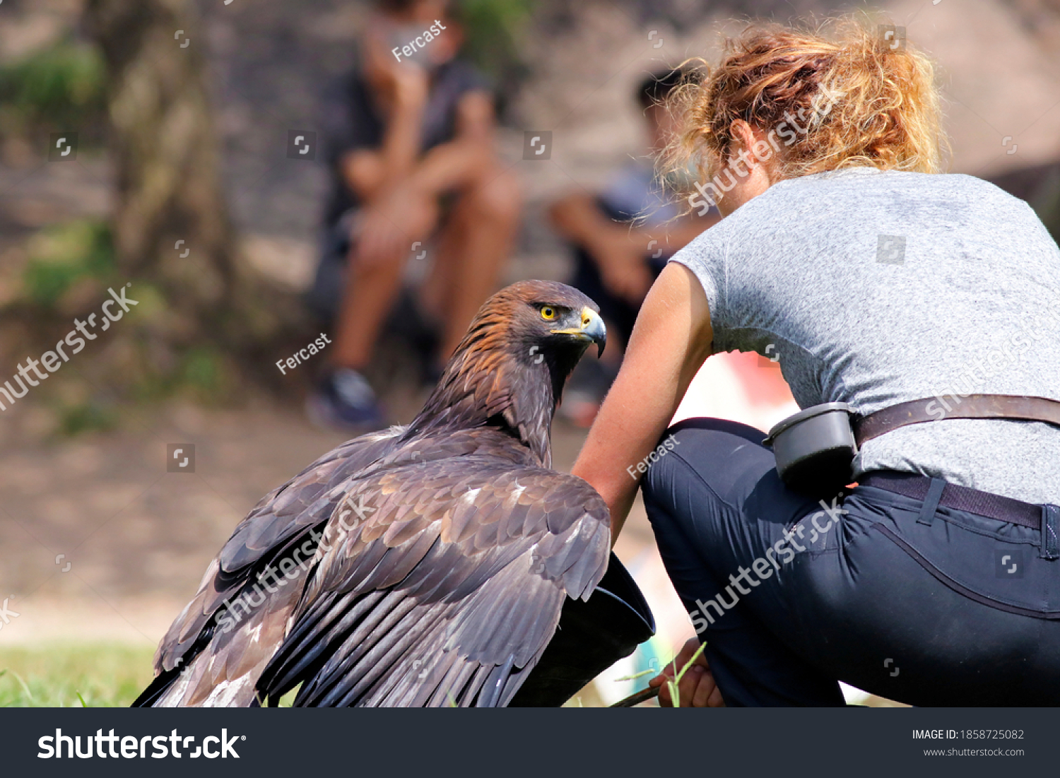 stock-photo-young-woman-holding-an-eagle